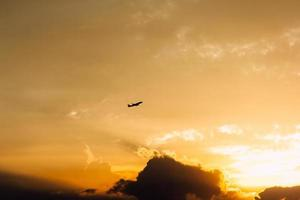 Silhouette of a plane during a sunset