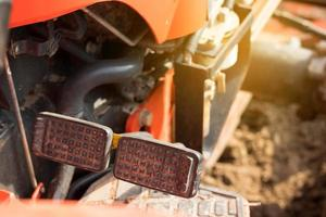 Brake and accelerator pedals for a tractor photo