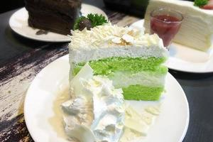 Close-up of a green and white cake photo