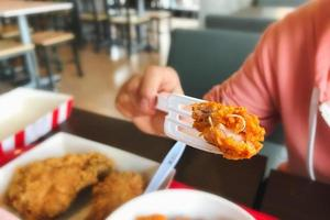 Close-up of fried chicken on a fork