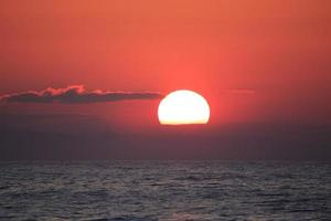 A beautiful sunset on the beach photo
