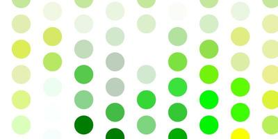 Light green, yellow vector background with spots.