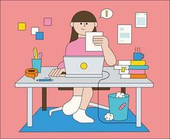 A woman is working at a desk