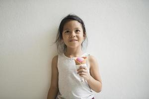 Portrait of a little girl eating ice cream photo
