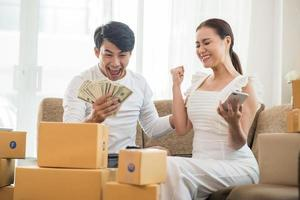 Happy couple at home office with online business