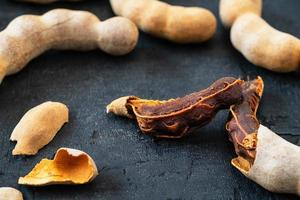 Fresh tamarind on a black background