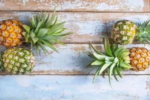 Pineapple fruit on a rustic wooden background photo