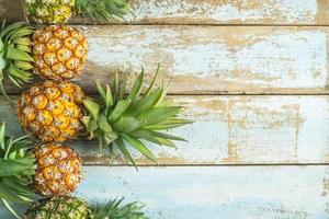 Pineapple on a wooden table photo