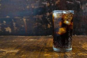 Cola on a table photo