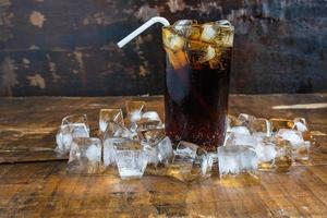 Iced cola with a straw photo