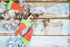 Ice cream sticks on a wooden table