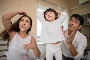 Happy child with parents playing photo