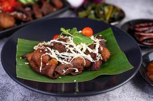 Fried pork topped with sesame seeds photo