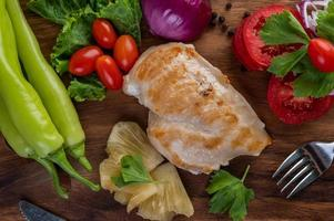 Chicken steak with assorted vegetables photo