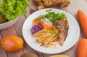 Fish with french fries and salad