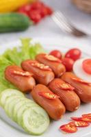Sausage links with peppers and cucumbers