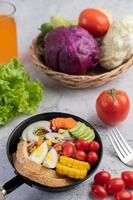 Vegetable salad with bread and boiled eggs