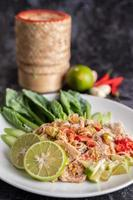 Spicy lime pork salad with greens and sides