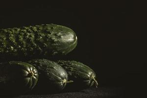 Cucumbers on dark background