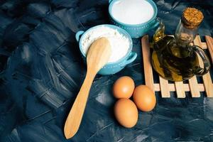 Baking ingredients with a wooden spoon