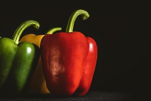 Bell peppers on a dark background