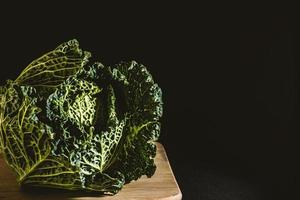 Cabbage on a wooden board with a dark background