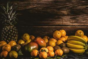 Yellow fruit on a wood background
