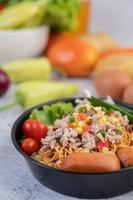 Stir-fried noodles with minced pork, edamame, tomatoes and mushrooms