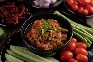 Sweet pork bowl with cucumbers, long beans and tomatoes
