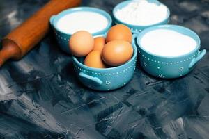 Blue bowls of baking ingredients