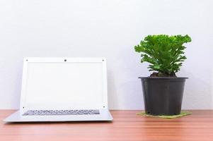 Laptop computer on the desk photo