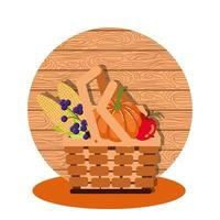 pumpkins with vegetables of autumn in wicker basket