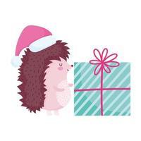 feliz navidad, lindo erizo con sombrero y regalo, caricatura, celebración, icono, aislamiento vector