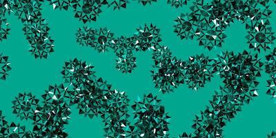Telón de fondo de vector verde claro con copos de nieve de Navidad.