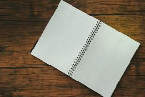 Notebook on brown wooden table photo