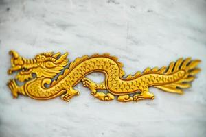 Selective focus  Chinese dragon, Golden Dragon, gold dragon on marble background