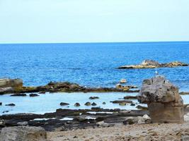Rocky coast with a blue ocean photo
