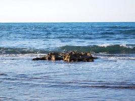 Blue seashore and rocks