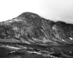 Grayscale of a rocky mountain