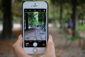France, 2020 - Person taking photo using a silver iPhone 5s