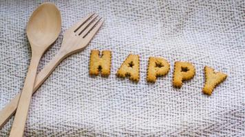 Happy cookies with silverware photo