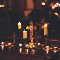 Cross surrounded by candles