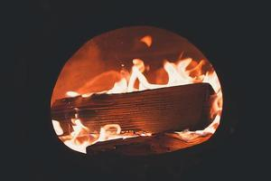 Burning wood in a fireplace photo