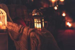 Candle lanterns with blankets photo