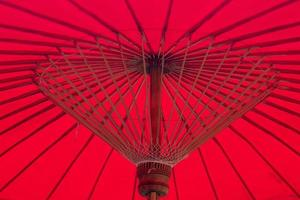 under red umbrella . bamboo structure .Asian background idea
