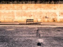 Empty bench near a street