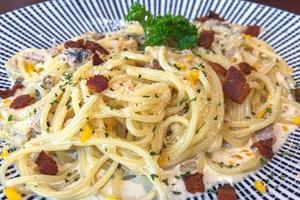 Spaghetti with pancetta. Hard parmesan cheese and cream sauce. Traditional italian cuisine. Pasta alla carbonara photo