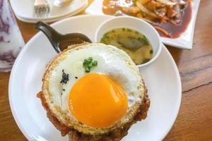 Fried egg on a plate photo