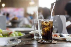 Glass of cola on table at the lunch time