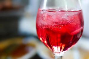 Glass of red juice photo